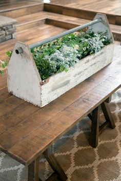 Perfect for a long table, Joanna regularly upcycles wooden tool boxes as charming centerpieces. Whether you find a wooden or metal version, tool boxes are easy to find when thrifting and can be used as planters, to hold towels and to keep toiletries corralled. Really, the options are endless.