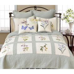 Designed with framed bouquets embroidered in a sampler quilt layout, the August Ethyl quilt brings pretty florals into your sleep space. The quilt is crafted from creamy white and blue cotton w Coverlet Bedding, Ruffle Bedding, Comforter Sets, Comforters, Main Image, Amity Home, Single Quilt, French Country Bedrooms, Quilt Sizes