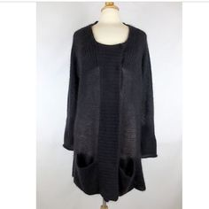 """Eileen Fisher Long Cardigan Gorgeous charcoal/eggplant  long cardigan with 5 hidden button snaps and 2 pockets at the very bottom. It has a woven texture and fits very cozy and chunky. 58% mohair, 37% nylon, 5% wool. 32"""" in length. In excellent condition Eileen Fisher Sweaters Cardigans"""