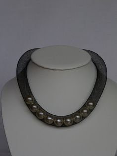 6600,- This 16mm black mesh necklace comes with 9 x 14mm pearls inside which move freely within the tube. This necklace is a lovely accessory for