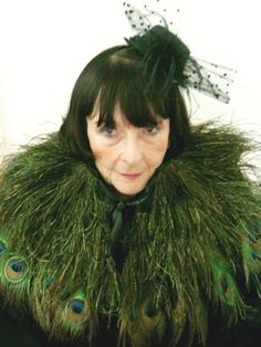 Jeanine Detry and she is an 84 year old Parisian Grandmother in Peacock Feathers