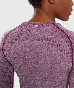 """Empowered through strength.- Midriff crop- Raglan sleeves detailed with figure-contouring shading- DRY technology- Thumb holes- 59% Nylon, 34% Polyester, 7% Elastane- Model is 5'7"""" and wears a size XS.- Label Color: Deep Magenta MarlEndeavour to perform in the Vital Seamless Long Sleeve Crop Top. Look and feel at your best in the gym with an elegant crop and form-enhancing fit combined with sweat-wicking technology and supportive fabrics. Shark Leggings, Tracksuit Bottoms, Athletic Wear, Dresses Uk, Long Sleeve Crop Top, Workout Leggings, Different Styles, Crop Tops, Hoodie Sweatshirts"""
