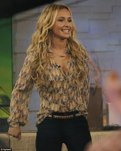 Plunging: Hayden Panettiere showed off her cleavage in a low cut blouse as she appeared on Good Morning America on Tuesday