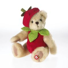 Make no mistake about it, Gala Appleseed's favorite fruit is the apple...and she's so sure, she designed her county fair garb to mimic it.  This golden bear is dressed in her own apple costume...right down to the apple stem cap, and green polka-dotted le