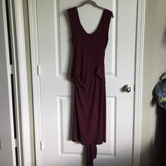 """Wine burgundy Red Dress with wrap around belt Flattering Dress with wrap around tie belt allows versatile style options with this dress, not sure on specific material but feels soft and is is giving on fit. Measures 48"""" from shoulder to bottom hem. Dresses"""
