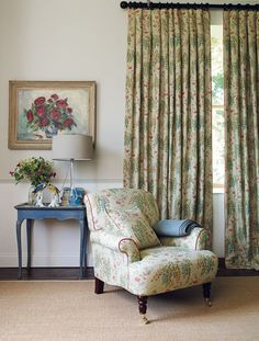 Classic sitting room interiors. With crisp walls, a floral chair and curtains. Product code LF1823.
