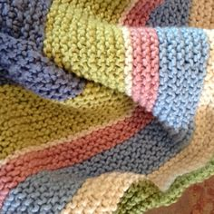 Baby blanket knitted with Nature's Choice Organic Yarn.  Free pattern on Lion Brand's website.