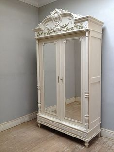 French antique Armoire with beautiful flowers and ivy carving