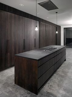 Kitchen in dark oak and concrete by John Smart Architects.