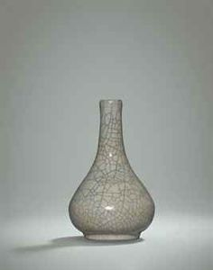 A VERY RARE SMALL GE BOTTLE VASE SONG DYNASTY OR LATER The vase is well-potted with a compressed bulbous body raised on a short cylindrical foot ring and tapers to a long neck terminating in a small slightly lipped mouth. It is covered with a thick cream-coloured glaze with a spiralling network of black crackles underlaid with finer golden-brown crackles. 5 3/4 in high