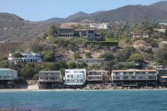 These are all some pretty sweet Malibu beach homes, but Beyonce's takes the cake. It's the giant brown one situated in the center of the picture, high above the others on the bright green grass. Basically, it's the one that looks much more expensive than all the rest.