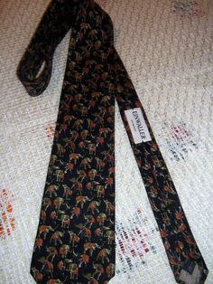Lot of 2 Ermenegildo Zegna vintage ties, elephants print, hound tooth print Black background with green and khaki elephants Black, white and red hound tooth and lines print Condition: excellent registered mail shipping Hounds Tooth, Elephant Print, Neckties, Elephants, Black Backgrounds, Floral Tie, Red, Etsy, Vintage