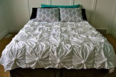 Tutorial on making this out of t-shirt sheets.  Would be a great idea for pillows too.