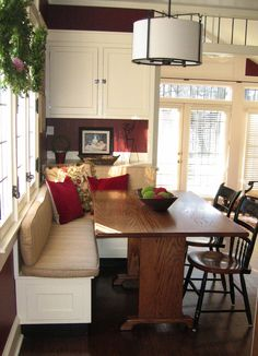 I like the built in behind the banquette. Could work next to the window in our kitchen?