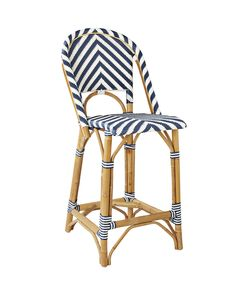 A classic 1930s European bistro chair, reinterpreted and elevated to new heights. Handcrafted of sustainable rattan and woven plastic seats, it