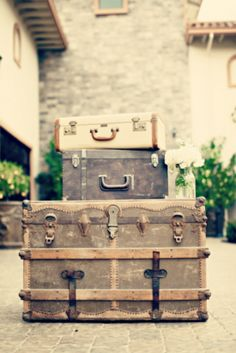 vintage trunks and suitcases.  perfect decor.
