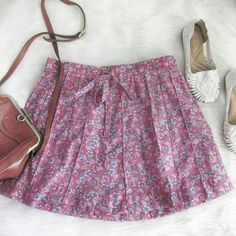 """Vintage 70s drawstring buttonfront skirt Like new condition! Broomsticks brand. Cute floral print. Drawstring waist. Bottoms down front. Length 16"""". Waist laid flat 16"""". Cotton poly blend.  Bundle for best deals! Hundreds of items available for discounted bundles! You can get lots of items for a low price and one shipping fee!  Follow on IG: @the.junk.drawer Vintage Skirts"""