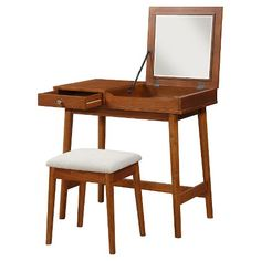 I adore most everything about this little table! 1) small,, easy to fit in many spaces & designs, 2)! Fold down mirror 3) simple lines ....I'm not loving the still, I would replace with a slipper chair, add a tray base to the bottom beam for more storage...maybe flank with inexpensive bookcases to make it more of an all purpose piece, maybe even paint! This is ok, because it' son vintage piece & my fave part is the $125 price!!! Mid Century Modern Vanity and Stool Set - Brown