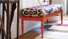 An old coffee table turned into an upholstered bench.