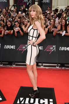 taylor swift bandage dress. Sideways picture, her stomach looks flat, so, why does she look like she has a pot gut in the picture taken from the front?