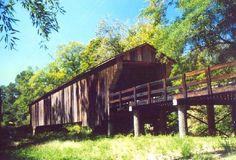 The Big Red Oak Creek Covered Bridge is the oldest covered bridge in the state, having been built about 1840, by Horace King, a former slave. It is owned and maintained by Merriweather County, and is still open to traffic to this day. It has the longest unsupported span, at 115 feet, of any covered bridge in the state. Georgia by the way