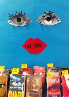 An 'eye-catching' display...Used CDs as eyes to highlight books with 'eyes' on their covers.