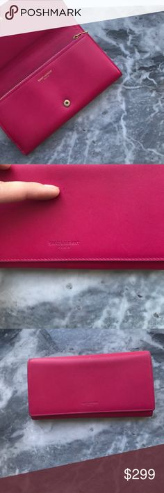YSL Saint Laurent classic long wallet in rose 💟AUTHENTIC CLASSIC SAINT LAURENT PARIS LARGE FLAP WALLET ( NO BOX COMES AS IS)  CLASSIC SAINT LAURENT FLAP WALLET WITH EMBOSSED SAINT LAURENT SIGNATURE. DIMENSIONS 7.4  3.9  1.0 INCHES 100% CALF-SKIN LEATHER SNAP FRONT CLOSURE 18 CARD SLOTS, 1 COIN POCKET 2 BILL & 2 RECEIPT COMPARTMENTS 💟CONDITION:: SEE PICS ON TINY DING ON FRONT ( pointing to it ) INSIDE TOP SMALL BLOTCH ( where my thumb is) INTERIOR IS CLEAN! LEATHER IS VERY GOOD…