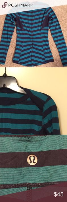 Lululemon blue striped running yoga top Navy and ocean blue striped top in lightweight, breathable fabric. Super soft and comfy, comes with thumb holes and tiny ruffles on the shoulders. lululemon athletica Tops Tees - Long Sleeve