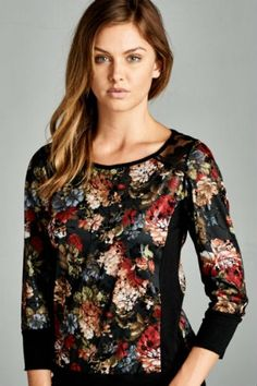Floral print top with foil accents. Shimmery lace shoulder insets. Solid contrast in rayon jersey. Fabric: 95% POLYESTER 5% RAYON. Made In USA