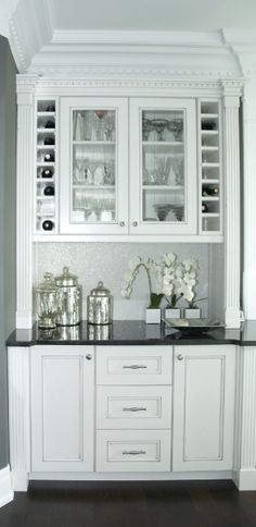Built In Bar Pantry Off The Kitchen White Cabinets Black Countertop