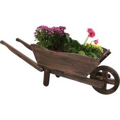 Made with durable cedar wood with a rustic antiqued finish, this Wooden Wheelbarrow Planter adds character to any garden. Garden In The Woods, Lawn And Garden, Garden Tools, Outdoor Planters, Outdoor Gardens, Garden Ideas To Make, Wagon Planter, Wheelbarrow Planter, Wooden Wagon