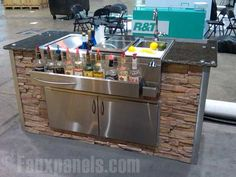 One of our customers wrapped their stainless steel portable bar with our faux stone panels for a more stylish look.     http://www.fauxpanels.com/img_c/14-wellington/design/050.jpg
