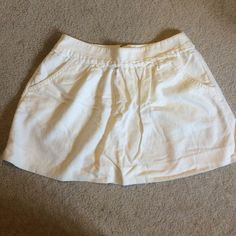 J. Crew white skirt J. Crew. Size 4. 2 pockets in front of skirt and zippers in back. Linen and cotton blend. J. Crew Skirts Mini