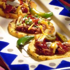 These sopes, or cornmeal cakes, make wonderful appetizers. Top them with a dollop of sour cream and a sprinkling of green onions or use refried beans with tomatoes and olives.