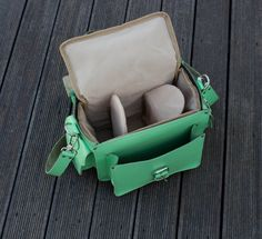 Leather Camera Bag, DSLR camera bag, Leather shoulder bag, Light Green Camera bag, plus light brown protective insert - LIMITED  We creating each item with heart and soul to be the perfect companion in your life or in the lives of your loved ones as a gift!   This model is our camera bag. It has one main compartment inside and a long removable shoulder strap, that can be adjusted to fit it. It is fastened on the middle front with a strap. Made from hard-wearing turquoise cow leather, these…