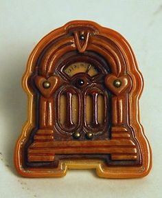 Vintage Bakelite Radio Pin. Completely adore!  #vintage #jewelry #brooches