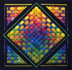 Woven Rainbow 1 -- http://www.conundrumquilts.com/wovenrainbow1.html