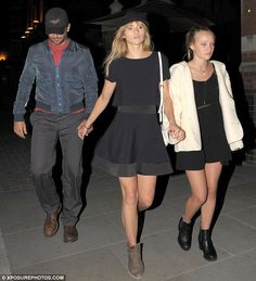 The leggy look: Suki Waterhouse walked hand-in-hand with beau Bradley Cooper and younger s...