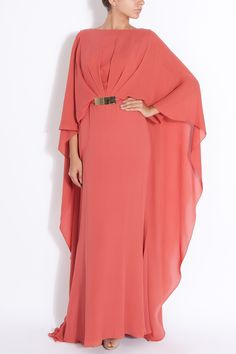 Elie Saab's Cape Style Georgette Gown showcases spectacular draped beauty. A high neckline, gold waist belt accent and irresistible coral colour make for a wonderfully unregreattable investment.