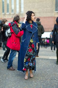 From a new look at florals to bold power suits, and jackets from the trench to the bomber—the ladies outside the shows are setting the style tone.
