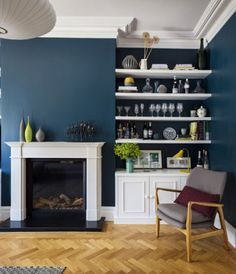 Interior design by Imperfect Interiors at this lovely Double Fronted Victorian house in East Dulwich, London. Oak parquet flooring, built in cabinetry, mid century chair and ceramics in the living room. Photography Ignas Jermosenka click now for info. Navy Living Rooms, Simple Living Room, Living Room Colors, New Living Room, Home And Living, Living Room Designs, Modern Living, Blue Living Room Walls, Kitchen Living