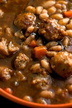 Cold-weather stew laden with white beans, sweet Italian sausage, rosemary, thyme, cumin and garlic. Sausage Stew, Beans And Sausage, Veggie Sausage, White Bean Soup, White Beans, Soup Recipes, Cooking Recipes, Bean Recipes, Cooking Bacon