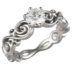 "Oooooh...  ""Floral infinity"" style band with solitaire diamond. <3 I may have a new favorite. There's even a matching wedding band."
