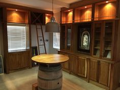 Wine barrel table is the centre feature of the wine room Wine Barrel Table, Cupboard, Centre, Room, Furniture, Home Decor, Clothes Stand, Bedroom, Armoire