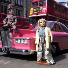 Lady Penelope and Parker this reminds me of my lovely brother Michael. He loved Lady Penelope and her pink car.