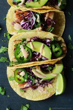 The BEST Grilled Mahi Mahi Fish Tacos you will ever have. Topped with crunchy purple cabbage, avocados, and a drizzle of Chipotle Lime Crema - all wrapped in a warm tortilla! All in under 20 minutes! | joyfulhealthyeats.com #recipes #grillseason