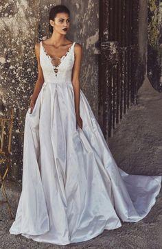 Glamorous plunging neckline ballgown wedding dress; Featured Dress: Elbeth Gillis