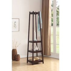 A contemporary take on a classic design, this freestanding coat rack lends inviting appeal to any entryway ensemble. Made from a mixture of solid and manufactured wood, this charming design features a pyramid-shaped frame with three open storage shelves that are perfect for placing purses, backpacks, baskets, or books, while eight two-pronged metal hooks accommodate all of your jackets, scarves, umbrellas, and hats. For a timeless foyer arrangement, start by rolling out a colorful…