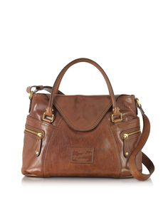 Icons Gaucho Medium Marrone Leather Tote is crafted in hand buffed vegetable dyed leather with double function design for a classic and sophisticated look. Featuring double rolled handles, adjustable shoulder strap, embossed logo plaque, zip top magnetic flap closure, two side outer zip pockets, internal zip and slip pockets. Gold tone brass hardware detail. Made in Italy.