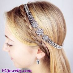 """Add a touch of wintry wonder to your 'do with this dazzling, haute-right-now headband. Both glamorous + oh-so-giftable, stunning crystal snowflakes beautifully accent a luxe antique rhodium-plated chain with touches of extra sparkle. Style Tip: For a vintage-inspired chignon, place the headband in your hair, then tuck your tresses over + under the band. antique rhodium-plated nickel-free plating 20"""" approx. length stretch fit clear crystal VGJewelry.com"""